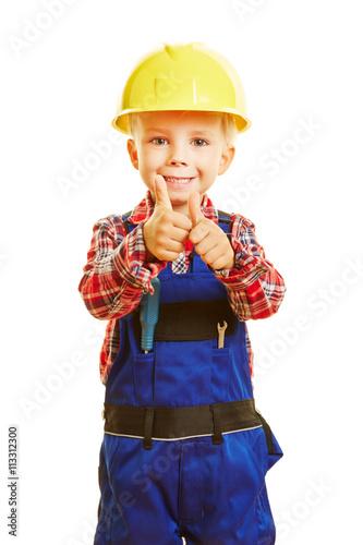 obraz lub plakat Kind als Handweker hält Daumen hoch