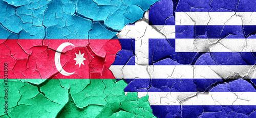 Zdjęcia na płótnie, fototapety, obrazy : Azerbaijan flag with Greece flag on a grunge cracked wall