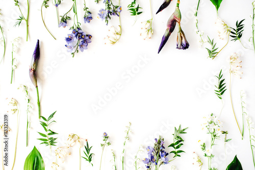 Fotobehang Lelietjes van dalen floral frame with purple iris flower, lily of the valley, branches, leaves and petals isolated on white background. flat lay, overhead view