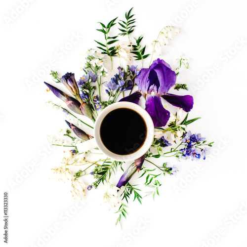 Aluminium Lelietjes van dalen Cup of coffee with purple iris and lily of the valley flowers. Flat lay, top view