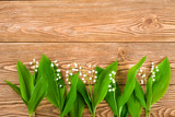 Lily of the valley on a wooden background