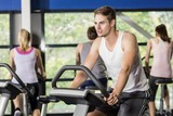 Fit man doing exercise bike