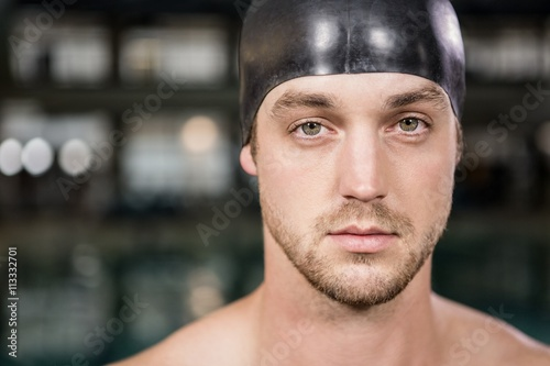 Portrait of swimmer standing by the pool Poster