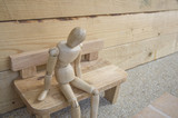 dummy wood man acting alone wooden chair