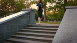 A young woman with shapely legs with metal rose going down the steps. Slow motion