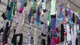 Clothing market, socks hanging on the rope in the Turkish market in the summer