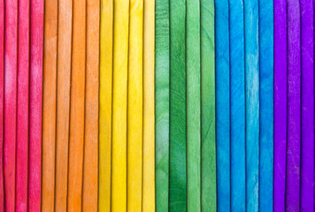 Abstract gay pride rainbow spectrum background on textured layered wood