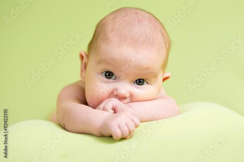 fototapeta na ścianę Baby infant kid lying on belly