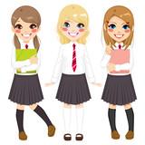 Cute European school girls friends happy together in school uniform