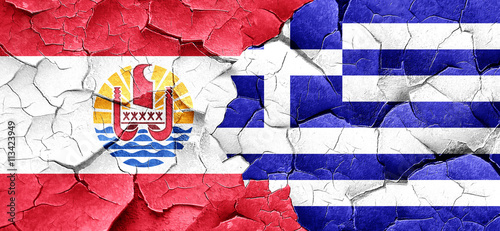 Zdjęcia na płótnie, fototapety, obrazy : french polynesia flag with Greece flag on a grunge cracked wall
