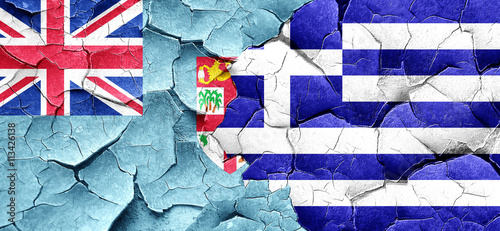 Zdjęcia na płótnie, fototapety, obrazy : Fiji flag with Greece flag on a grunge cracked wall