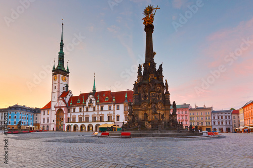 Town hall and Holy Trinity Column in the main square of the old town of Olomouc, Czech Republic Poster