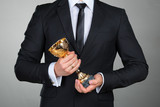 Businessman holding golden cup trophy - 113447156