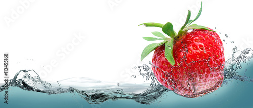 Juicy strawberry on a background of splashing water. - 113455168
