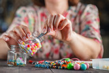 Woman making home craft art
