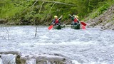 Slow motion. People tourists  on  boat , kayak rafting. Blurred scene