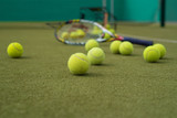 Close up view of balls and tennis racket  on the tennis court