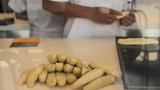 A man making pieces of dough