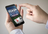 touchscreen smartphone with poker online on the screen