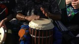 Young people sing and play drums in a City Park. Slow Motion.