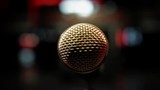 View at microphone on stage of nightclub. Spotlights. Cheering. Live concert. Performance. Sound equipment. Close up