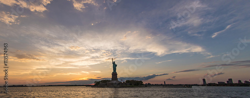 dramatic panorama of Statue of Liberty during sunset - 113574963