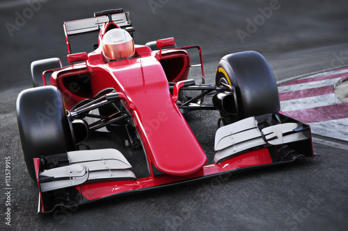 Fototapeta Motor sports race car Front angled view speeding down a track . 3d rendering
