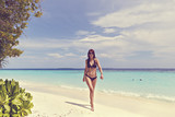 a beautiful woman on a tropical beach