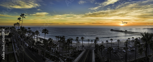 This is a colorful three image aerial sunset panoramic of Oceanside, California, USA. Oceanside is 40 miles North of San Diego, California.