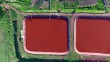 Red lakes in industrial part of Kryvyi Rih, Ukraine, aerial shoot