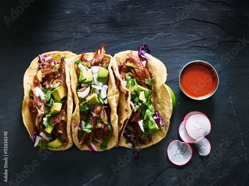 Plagát three mexican pork carnitas tacos flat lay composition