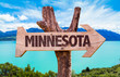 Minnesota wooden sign with landscape background