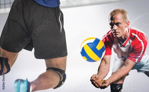Fototapeta Composite image of rear view of sportsman posing while playing volleyball