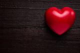 Red heart over dark-brown wooden background - 113692530