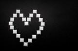 White heart made from white bricks over black textured background - 113692729