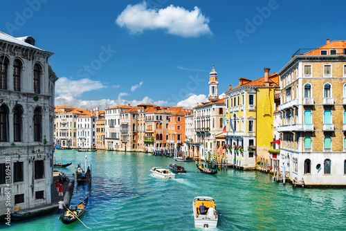 The Grand Canal with gondolas and boats. Colorful houses, Venice Poster