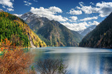 Scenic view of the Long Lake among mountains and fall woods