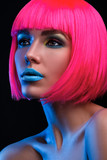 Potrait of young woman with pink hair