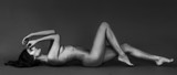 Fototapety Sensual naked woman portrait with gorgeous body lying letterbox