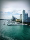 Marina of Boats on Ocean Surrounded by High-Rises
