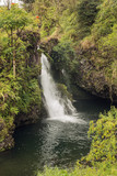 Idyllic waterfall in the tropical forest on the road to Hana..