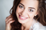 Portrait of smiling woman with perfect smile and white teeth looking at camera - 113757765