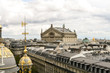 Panoramic view of Paris. Roofs of houses and the Opera Garnier.