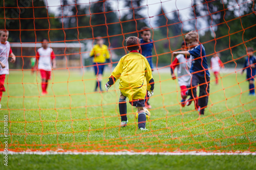 Young soccer goalie preparing to make a save