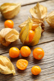 Fototapety Ripe physalis on a grey wooden table