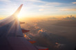 View of the sunset,clouds and airplane wing from the Inside - 113800916