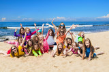 Group of happy children on the beach