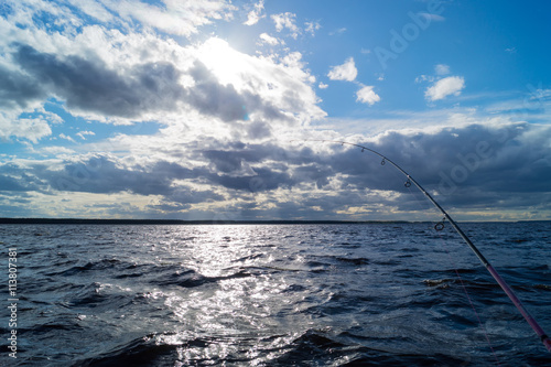 fishing from a boat, Trolling fishing boat rod, sky scenery above the water Poster