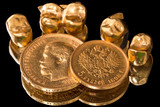 Gold coins and dental crowns