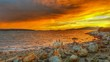 Sunset clouds burning on beach